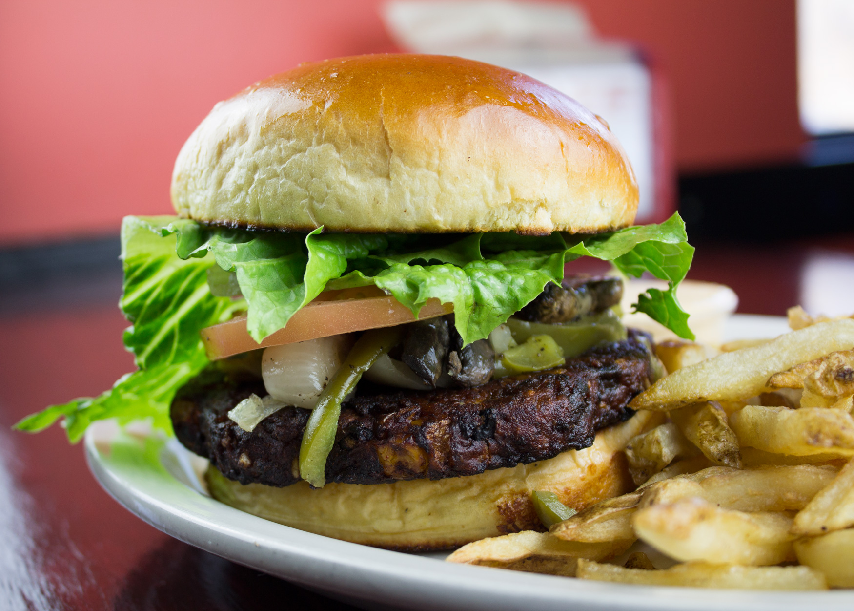 BLACK BEAN CHIPOTLE PHILLY BURGER. Southwestern Style veggie patty made with brown rice, black beans, and chipotle pepper. Served on a warm homestyle bun with your choice of cheese & toppings